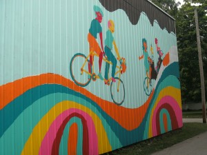 New mural on the alley wall of the Bike Shop